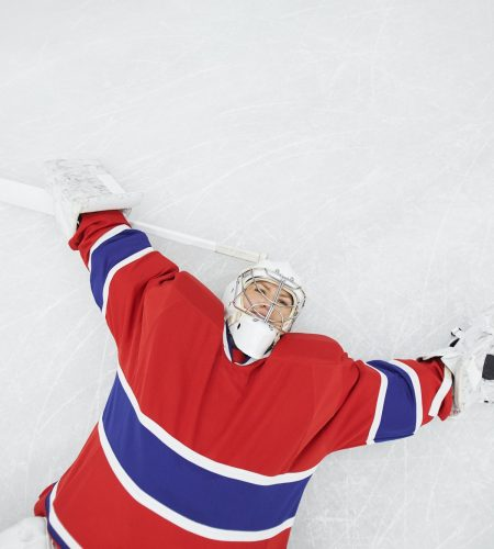 Female Hockey Player Lying on Ice